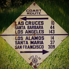 Did Somebody Say Roadtrip? (nedlugr) Tags: california ca usa sign autoclub aaa mileage textured antique santabarbaracounty coastroute highway101 rust grass green losalamos acsc