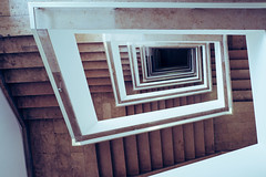 Downstairs (Art de Lux) Tags: white berlin stairs germany deutschland stair stairwell treppe staircase handrail railing treppen treppenhaus geländer federalforeignoffice brown architecture geometry architektur braun angular eckig geometrie weis artdelux auswärtigesamt