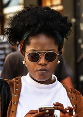 Portrait (D80_538605) (Itzick) Tags: denmark copenhagen candid color colorportrait streetphotography shades blackwoman face facialexpression cellphone earrings portrait d800 itzick