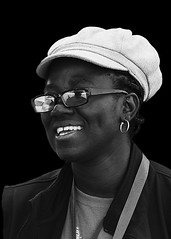 Portrait (D80_538341) (Itzick) Tags: denmark copenhagen candid bw blackbackground blackwoman streetphotography smile shades portrait d800 itzick