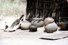 79-092 (ndpa / s. lundeen, archivist) Tags: nick dewolf color photograph photographbynickdewolf 1976 1970s film 35mm 79 reel79 africa northernafrica northeastafrica african ethiopia ethiopian southernethiopia rural village building house home sticks branches wood jugs bowls containers villagelife rurallife