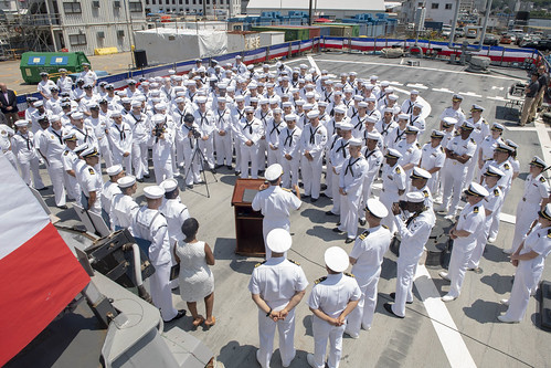 Adm. John Aquilino speaks to the crew of USS John S. McCain (DDG 56) during an awards ceremony.