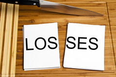 Knowing When to Cut Your Losses (znfrjvms29) Tags: word cut loss finance money lose bank banking economy business financial investment knife kitchen concept paper solution closeup cutting wood blade split wooden board