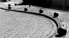 Siguiendo la acera. (Ricardo Pallejá) Tags: monocromo monocromático blancoynegro bw blackandwhite nikon d500 urbana urban urbanexploration street sombras shades silueta sun falset priorat piedra pueblo turismo lightroom light luces catalonia cataluña calle catalunya contraluz tarragona travel textura