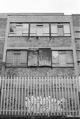 (a.pierre4840) Tags: olympus om3 zuiko 35mm f28 35mmfilm ilford ilfordhp5 hp5 hp5plus bw blackandwhite noiretblanc architecture perspective grey urban decay london england graffiti windows