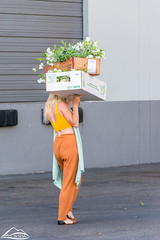 Woman carrying flowers (Washington State Department of Agriculture) Tags: june summer wsdagov washingtonstatedepartmentofagriculture agriculture flower flowers washington washingtonstate wsda