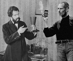 Alexander Graham Bell and Steve Jobs are seen arguing the merits of their respective inventions, and the relative cultural impacts wrought by each. (Fotofricassee) Tags: alexander graham bell steve jobs telephone iphone afterlife