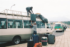 The Riverside shuttle bus packing up our luggage after passing through Tanzanian customs, Tanzania, June 2019 (etoms) Tags: africa film etabroad olympusom1 portra400 travel tanzania mtkilimanjaro