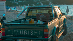 Sand Worn Pickup (sgordon427) Tags: truck car green turquoise beach samos greece mitsubishi golden hour nikon camera nice sunset back