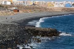 Golf del Sur, San Miguel de Abona, Santa Cruz de Tenerife, Canary Islands (wildhareuk) Tags: beach canaryislands canon canoneos500d people sea seascape spain tamron18270mm tenerife tenerife2019 village water pebble rock tamron img9508dxo