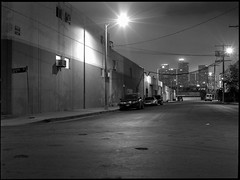 Sotello Street (ADMurr) Tags: la night dtla from north street warehouse streetlamp 100 dbb064 hasselblad 500cm 80mm zeiss planar 645 mask fuji acros bw black white