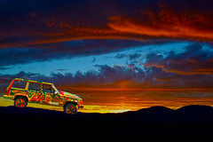 One Love, One Jeep (oybay©) Tags: jeep jeepcherokee cherokee color colors colorful reggae rasta suncitywestarizona suncitywest arizona lowkey subtle beardsleydrive car automobile suv hubcap wheelcover yellow orange blue red green primarycolors cool unique unusual different parked sunset greatbasinnationalpark greatbasin great basin national park beamoflight beam light mountain startrain nevadanorthernrailroad nevadanorthern railroad train clouds amazing bestphotograph nikon religious experience london nevada