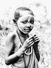 Suri Girl (Rod Waddington) Tags: africa african afrique afrika äthiopien ethiopia ethiopian ethnic ethnicity etiopia ethiopie etiopian outdoor omovalley omo omoriver south blackandwhite monochrome suri tribe traditional tribal portrait painted face culture cultural child