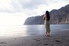 Waiting for somebody (PawleOle) Tags: beach woman girl sea landscape seascape longexposure outside bright water rocks losgigantes tenerife waiting lonely