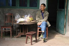 Xieyuan, having a rest (blauepics) Tags: china sichuan province provinz xieyuan village dorf house haus privat simple einfach rural ländlich man mann farmer bauer face gesicht smoking rauchen rest pause sit sitzen relaxed entspannt