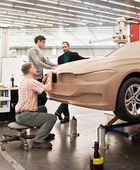 BMW's new head of exterior design, Christopher Weil, and former BMW Cars design director Karim Habib working with a clay modeler on the F30 3 Series #flashbackfriday #bmw #3series #cardesign #claymodel #automotivedesign #vehicledesign #formtrends (Eric G.) Tags: car design form trends formtrendscom