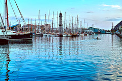 Port Vell - long time no see (Fnikos) Tags: port porto puerto harbour harbor sea mar mare water waterfront color colour colores colours colors shadow shadows reflection boat sailboat ship sky cielo building tower architecture people sport sports rowing cloud clouds outside outdoor