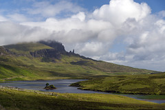 Old Man in the Distance (syf22) Tags: water watercourse viewpoint isleofskye mountains hill spectacular view distance trotternish peninsula rocky massive pinnacle iconic road hillside blue oldmanofstorr picturesque panoramic