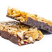Healthy Cereal Bar with Cranberries and Milk cream above white background