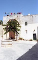 Mdina (fraser_west) Tags: film analog 35mm kodak gold malta mdina town travel canon eos3 well tree clothes journal wetheconspirators