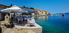 Valun on island Cres (Robert Stärz) Tags: croatien insel valun cres meer blau himmel strand konoba croatia sea local parasol panorama blue kvarnerbucht istrien bay istria kroatien travel tourism architecture building water destination town