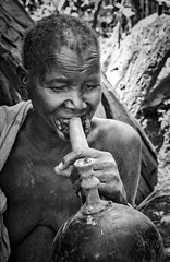 Suri Calabash Pipe (Rod Waddington) Tags: africa african afrique afrika äthiopien ethiopia ethiopian ethnic ethnicity etiopia ethiopie etiopian outdoor omovalley omo omoriver suri tribe traditional tribal smoking calabash pipe grandmother woman blackandwhite monochrome portrait people