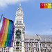 Raised rainbow flags in front of the New Town Hall at Marienplatz in Munich, with the title
