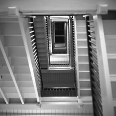 vertigo (kaumpphoto) Tags: rolleiflex 120 tlr street ilford bw black white stairs interior abstract wood parallel psychological gradation concentric hp5 vertigo dizzy