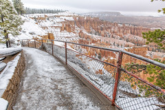 Traction Required (garshna) Tags: brycecanyonnp snow hiking canyon fence railing hoodoos clouds trees