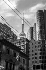 Drowning (Aaron Allen Rogers Toronto) Tags: bnw black white toronto city downtown architecture cn tower sky summer bright sunny outdoors buildings reflections clouds contrast shadows light lighting wide narrow
