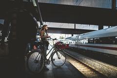 Biker waiting for her train (Diggoar) Tags: bicycle düsseldorf düsseldorfhbf street streetphotography streetscene trainstation ricohgr ricoh 28mm urbandocumentaryphotography trains ice