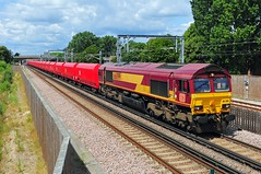 66099 seen on the 11.07 Angerstein Wharf to Wembley working with a rake of newly refurbished wagons at Abbey Wood on 12-7-19. Copyright Ian Cuthbertson (I C railway photo's) Tags: class66 66099 abbeywood ews shed