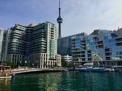 Beautiful Toronto (i_kaya@rogers.com) Tags: toronto canada ontario photo photograph photography lake lakeontorio boat sailboat buildings street flag tower cntower