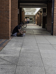 A Noisy Candid (Charliebubbles) Tags: olympusem5mkii olympus1250mmez cheshire crewe victoriacentre photoshopcc candid street 2019 unitedkindom
