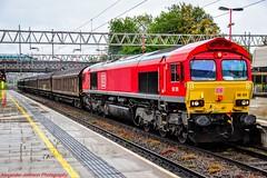 66124 @ Stafford (A J transport) Tags: class66 66124 dbcargo red wcml freight diesel locomotive railway trains track england nikkon d5300 dlsr stafford platform raining wet