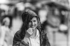 Smiling despite the rain (Frank Fullard) Tags: frankfullard fullard candid street portrait smile rain wet weather happy lady monochrome black white blanc noir ballina mayo irish ireland festival