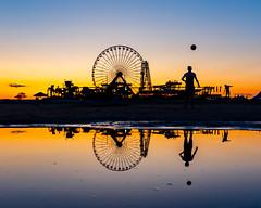 Reflections on Wildwood (Derek Boen) Tags: wildwood newjersey beach shore amusementpark silhouette sunset reflection pentax pentaxk1 pentax1530 ferriswheel