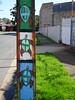 Tortoise Pole (mikecogh) Tags: hendon telegraphpole tortoises stobiepole shells publicart grass footpath pavement