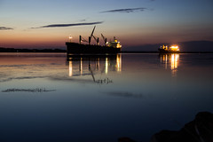All still and silent (soniamarmen) Tags: sunset stlawrence river quebec canada cal water colours blue hour ships reflection lights dusk nightfall stillness