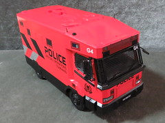20190713160520 (imranbecks) Tags: 124 spf tactical vehicle tav ptu soc sg singapore police force diecast scale model polwel special operations command unit ang chia red mercedes mercedesbenz 1023a ym1953d collectible benz