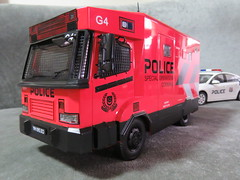 20190713161646 (imranbecks) Tags: 124 spf tactical vehicle tav ptu soc sg singapore police force diecast scale model polwel special operations command unit ang chia red mercedes mercedesbenz 1023a ym1953d collectible benz