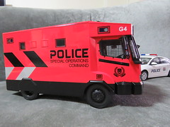 20190713161839 (imranbecks) Tags: 124 spf tactical vehicle tav ptu soc sg singapore police force diecast scale model polwel special operations command unit ang chia red mercedes mercedesbenz 1023a ym1953d collectible benz