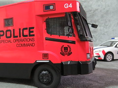 20190713161749 (imranbecks) Tags: 124 spf tactical vehicle tav ptu soc sg singapore police force diecast scale model polwel special operations command unit ang chia red mercedes mercedesbenz 1023a ym1953d collectible benz