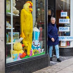Halifax 015 (Peter.Bartlett) Tags: olympusomdem1 shopfront window unitedkingdom people streetphotography doorway westyorkshire colour peterbartlett urban candid uk m43 microfourthirds shopwindow sign woman walking halifax england