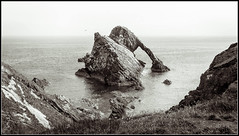Bow Fiddle Rock (Donald Noble) Tags: moray portknockie scotland arch beach cave coast coastline duotone engineering landscape monochrome postprocessed rock sea water