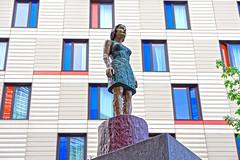 Wooden Lady (Croydon Clicker) Tags: sculpture statue wood wooden painted plinth hotel building windows wall london londonbridge nikon sigma