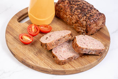 Sliced Pork and Chicken Meat Loaf with Tomatoes on the board (wuestenigel) Tags: meatloaf cumin sauce slice dish roasted background ground red vegetarian homemade cooked loaf ripe meal baked vegetable tomato closeup cherry plate holiday isolated gourmet pepper nobody food dinner ingredient prepared cuisine organic pork meat traditional beef sliced delicious white