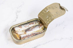 Opened Canned Sardines Fish on the table (wuestenigel) Tags: oil appetizer packaged background snack container tinned conserved dietary isolated protein metal tin eating white seafood food omega closeup gourmet metallic breakfast ring preserve fish healthy olive diet preserved palatable nutrition cuisine open prepared product can lunch meal canned steel conserve sprat sardine