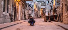Easy Rider at the Me'ah-Shearim's Luna park… (ybiberman) Tags: israel jerusalem meahshearim ultraorthodoxjews jews ultraorthodox boy payot people portrait candid streetphotography documentary evening lighting streetlighting tricycle sliding