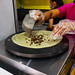 Lady preparing to cook a chocolate crepe